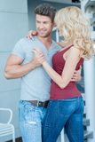 Happy Couple Dancing with Arms Around Each Other Stock Photography