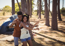 Happy couple dancing on field Royalty Free Stock Photography