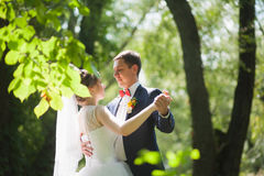 Happy couple dancing in green park royalty free stock photography