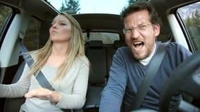 Happy couple dancing like crazy in car. Happy couple having fun dancing in car