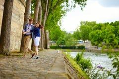 Happy couple is dancing in Paris stock image