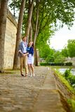 Happy couple is dancing in Paris Stock Images