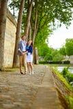 Happy couple is dancing in Paris stock images