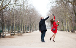 Happy couple dancing in a park. Happy couple dancing in the Luxembourg garden of Paris Royalty Free Stock Photos