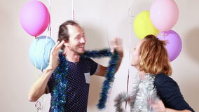 Happy couple dancing in photo booth. Happy couple dancing in party photo booth stock footage