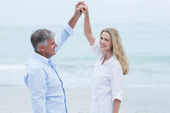 Happy couple dancing by the sea Stock Photos