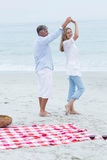 Happy couple dancing by the sea Stock Photography