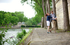 Happy couple is dancing on the Seine embankment Stock Photo
