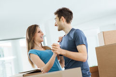 Happy couple dancing in their new house Royalty Free Stock Image