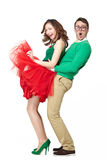 Happy couple dancing together. Full body studio portrait of happy couple dancing together. Cute asian teenage girl and nerd young men wearing fifties style royalty free stock photography