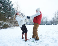 Happy couple dancing in winter snow Royalty Free Stock Image