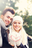 Happy couple on a date in the park Stock Images