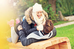 Happy couple on a date in the park Stock Photography