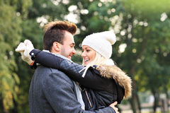 Happy couple on a date in the park Royalty Free Stock Image
