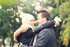 Happy couple on a date in the park Royalty Free Stock Photos