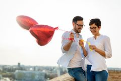 Happy Couple Dating And Smiling While Blowing Bubbles Royalty Free Stock Images