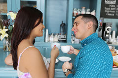 Happy couple dating at cafe, looking at each other fall in love. Stock Photos