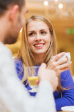 Happy couple dating and drinking tea at cafe Stock Photography