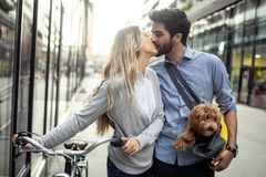 Happy couple dating on sunny day in the city. Happy young couple dating on sunny day in the city royalty free stock image