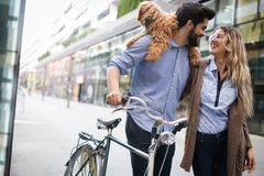 Happy couple dating on sunny day in the city. Happy young couple dating on sunny day in the city royalty free stock photography