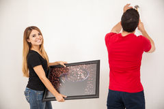 Happy couple decorating Stock Photo