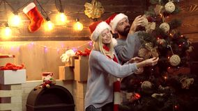 Happy couple decorating Christmas tree. New year couple. The morning before Xmas. Merry christmas and Happy new year. stock footage