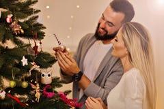 Happy couple decorating christmas tree Stock Photo