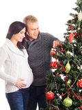 A happy couple decorating the Christmas tree Royalty Free Stock Images