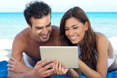 Happy Couple With Digital Tablet Royalty Free Stock Photos