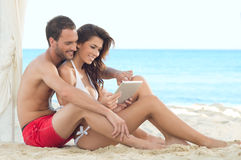 Happy Couple With Digital Tablet Stock Photography