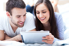 Happy couple with digital tablet Stock Photo
