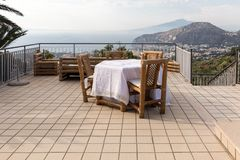 A happy couple at dinner on a terrace overlooking the bay of Naples and Mount Vesuvius. Sorrento. Prepared for supper table on the terrace overlooking the Bay of stock images