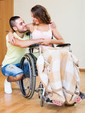 Happy couple with disabled spouse Stock Photography