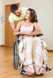 Happy couple with disabled spouse Royalty Free Stock Images