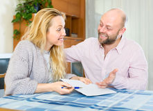 Happy couple discussing marriage settlement Royalty Free Stock Photography