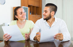 Happy couple with documents indoors Royalty Free Stock Images