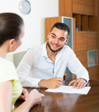 Happy couple with documents indoors Stock Photo