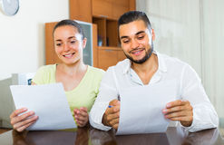 Happy couple with documents indoors Royalty Free Stock Image