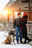 Happy couple with dogs in winter forest. Lovely moments outdoor stock image