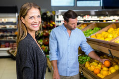 Happy couple doing grocery shopping Royalty Free Stock Photo