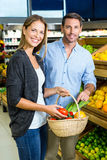 Happy couple doing grocery shopping Stock Photography