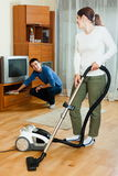 Happy couple doing housework together Stock Image