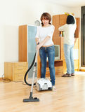 Happy couple doing housework Royalty Free Stock Image