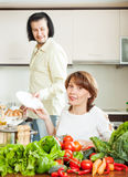 Happy couple doing housework together Royalty Free Stock Image