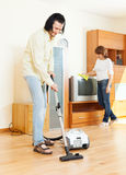Happy  couple doing housework together Royalty Free Stock Photo