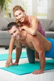 Happy couple doing push ups Royalty Free Stock Photo