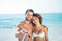 Happy couple doing selfie with monopod Stock Photography