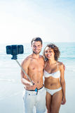 Happy couple doing selfie with monopod Royalty Free Stock Photos