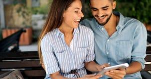 Happy couple doing shopping on internet Stock Photo