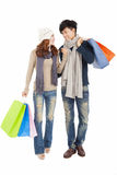 Happy couple doing shopping isolated on white Stock Photography